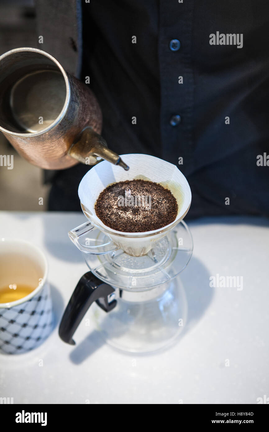 moment of coffee brewing - Stock Image