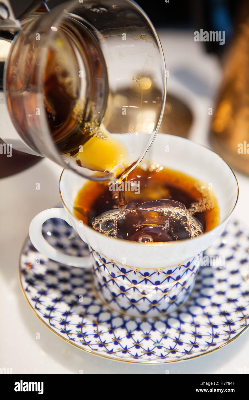 pour coffee into cup - Stock Image