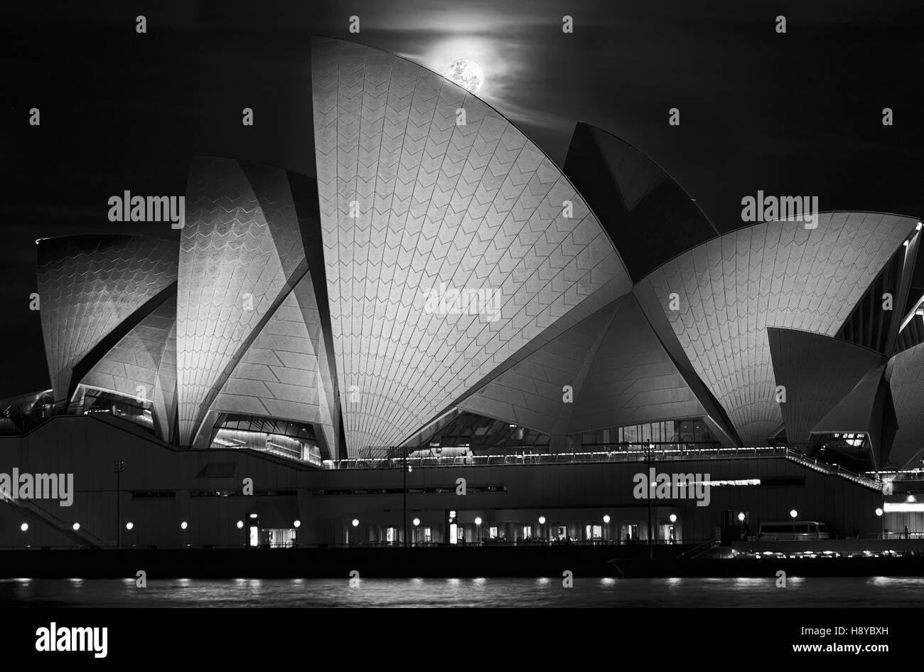 Sydney, Australia - 15 November 2016: Super full moon rising over Sydney Opera House in Australia during unique - Stock Image