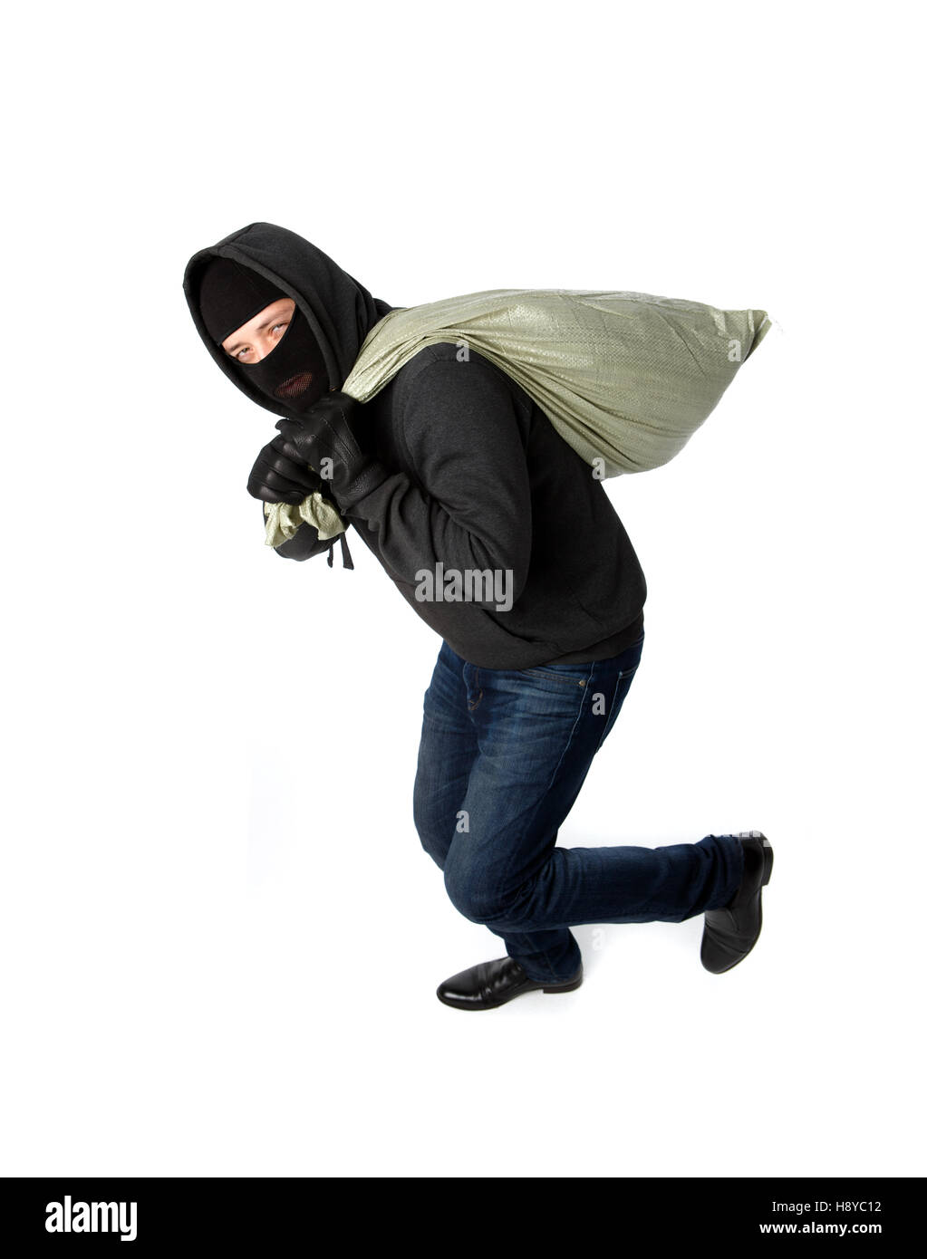 Thief running away with bag Stock Photo
