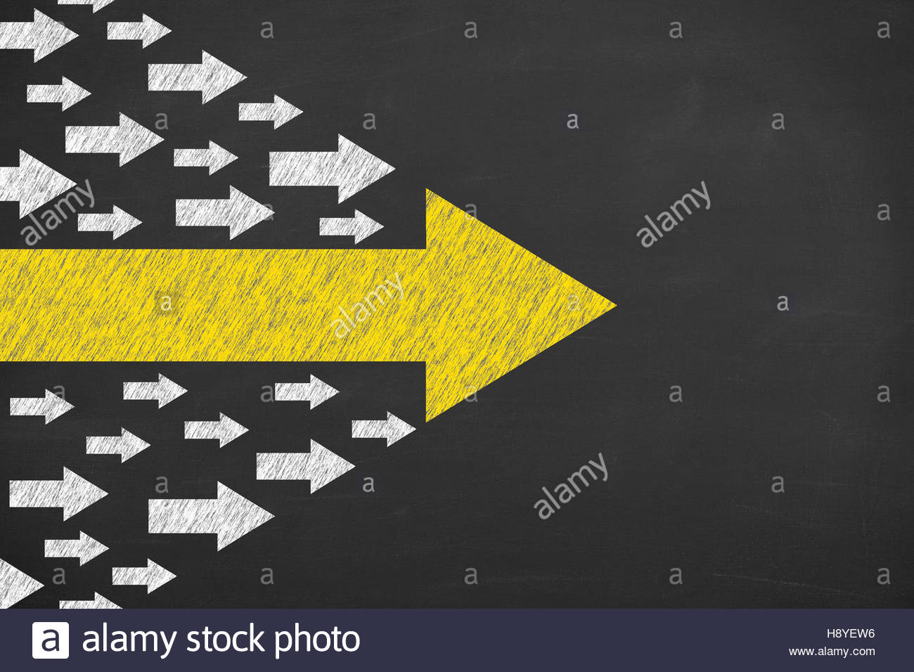 A business man is drawing Leadership concept with arrows on chalkboard background - Stock Image