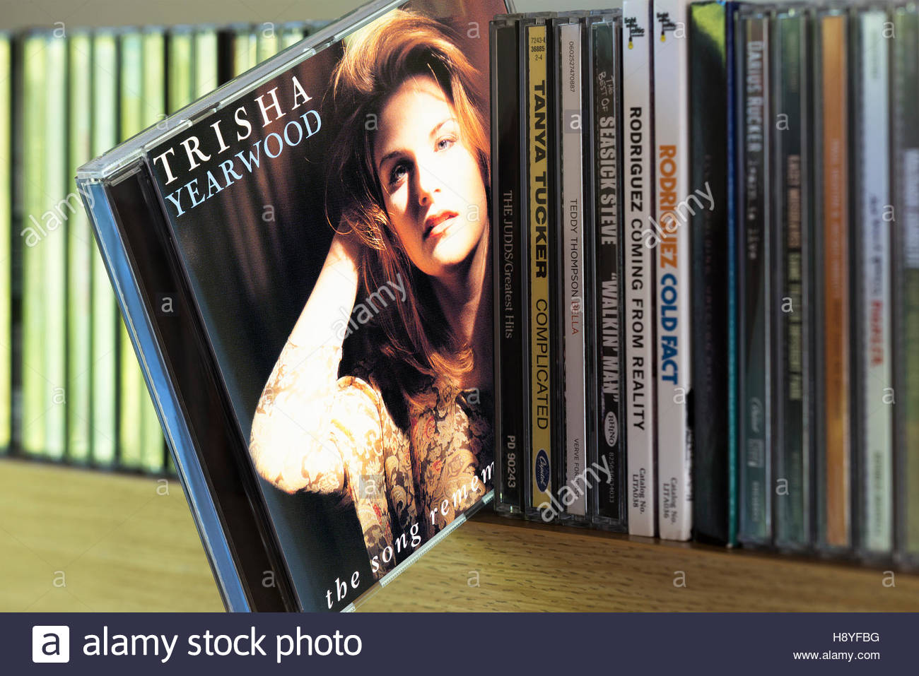 The Song Remembers When, Trisha Yearwood CD pulled out from among other CD's on a shelf Stock Photo