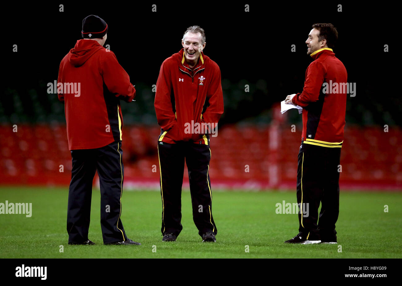 Wales coach Rob Howley shares a joke with coaching staff Neil Jenkins and Matt Sherratt a training session at the - Stock Image