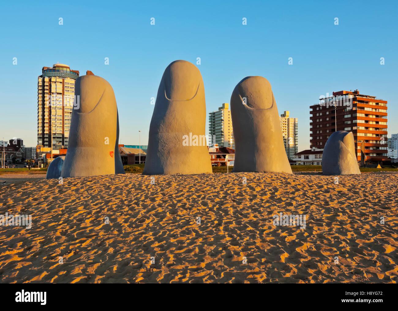 Uruguay Maldonado Department Punta del Este Playa Brava La Mano(The Hand) a sculpture by Chilean artist Mario Irarrazabal - Stock Image