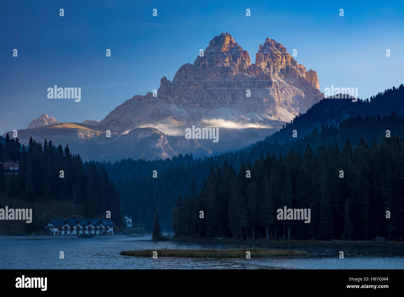 Tre Cime of the Dolomites tower over Lago Misurina, Belluno, Italy - Stock Image