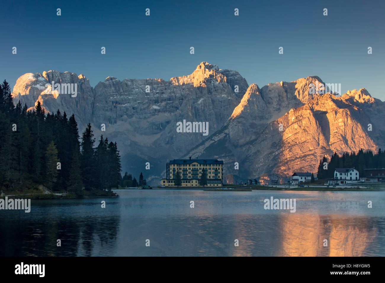 The Marmarole and Sorapiss Groups of the Dolomites tower over Istituto Pio XII - a private hospital on Lago Misurina, - Stock Image