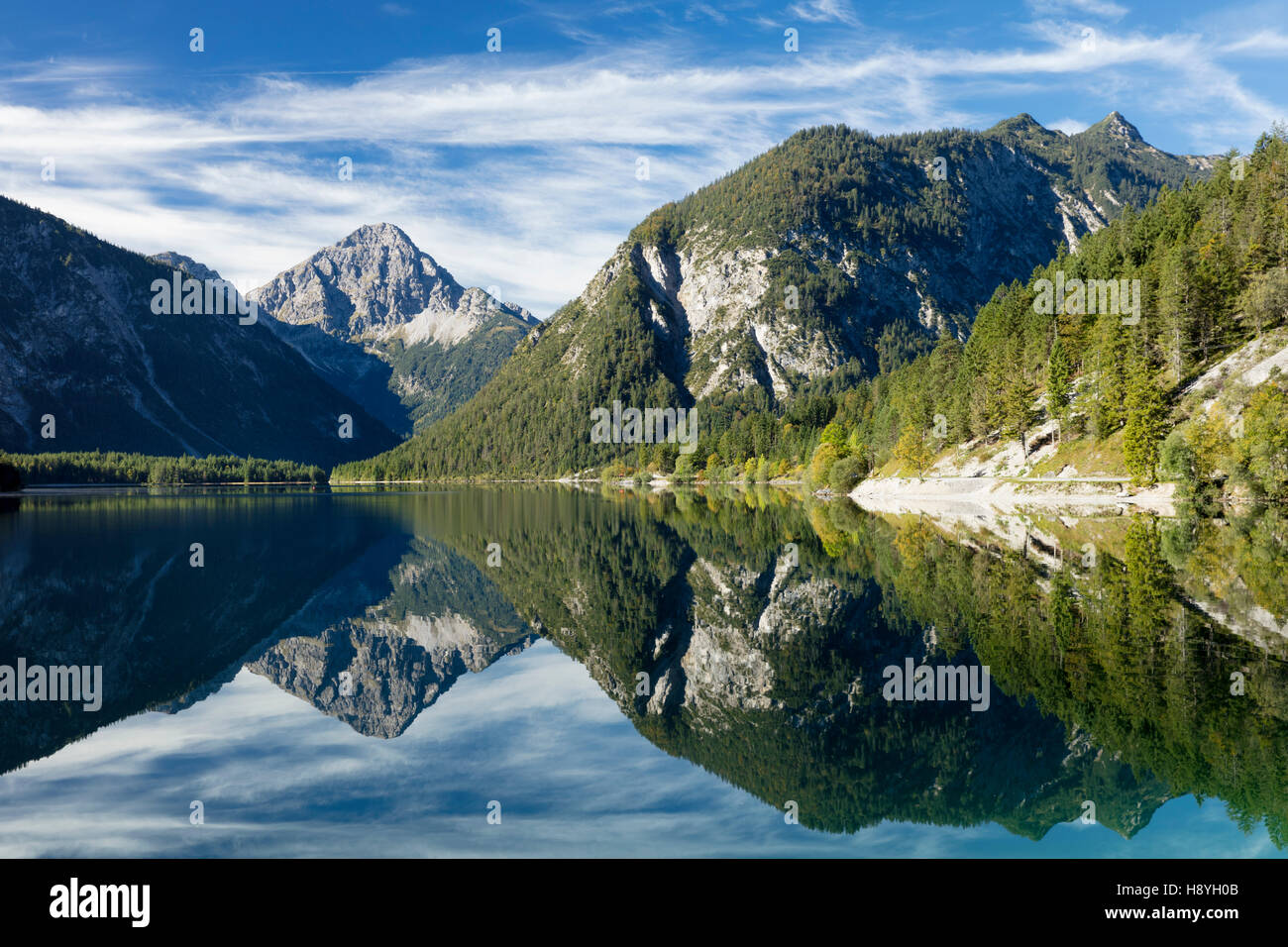 Tyrolean Alps reflected in Plansee, Tyrol, Austria Stock Photo