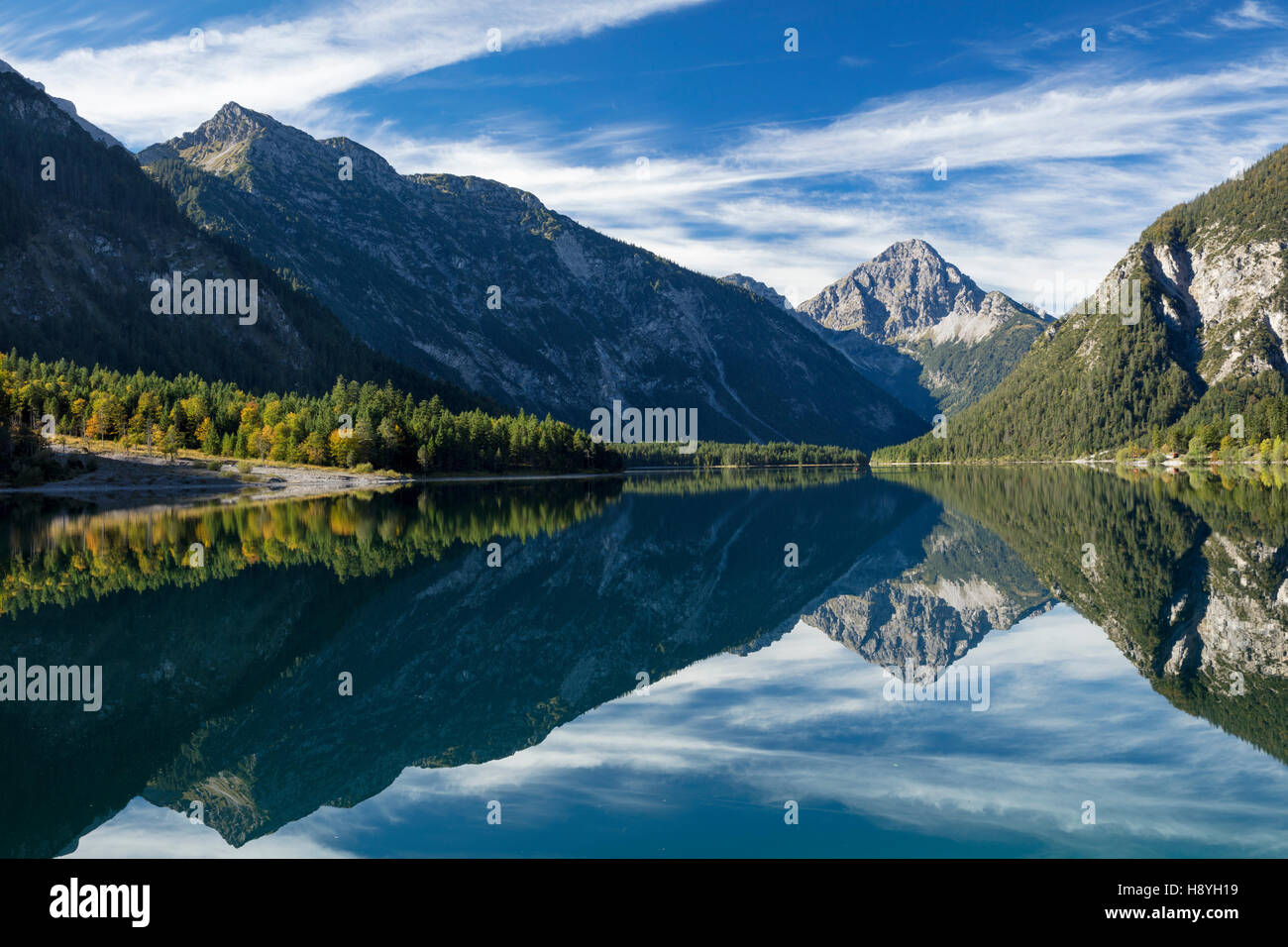 Tyrolean Alps reflected in Plansee, Tyrol, Austria - Stock Image
