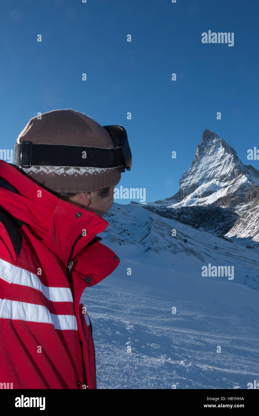 Cervinia Zermatt Ski Instructor looking at the Mont Cervin Cervino Matterhorn from skiing up the the glacier Plateau - Stock Image