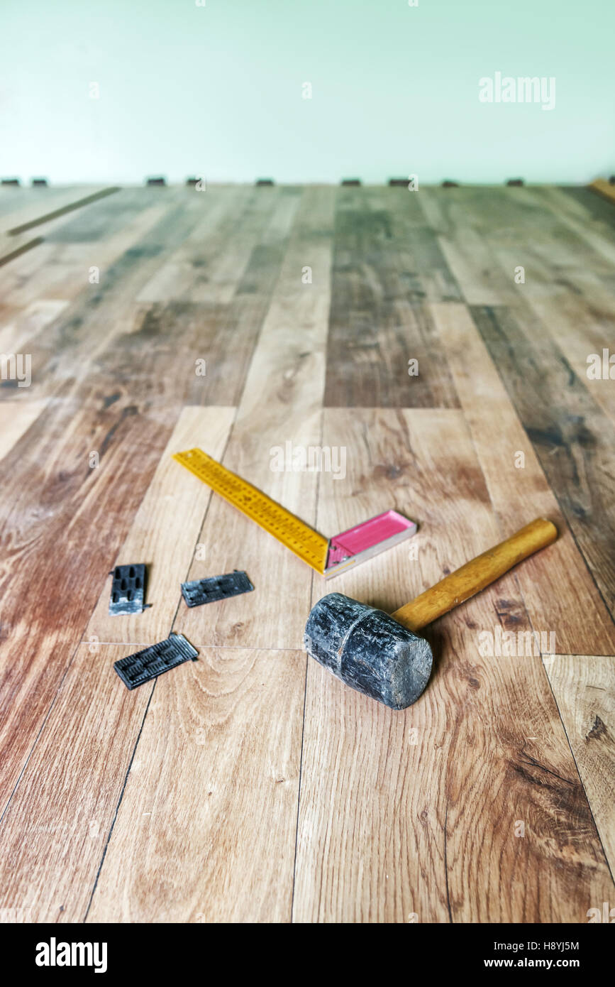 instrumets for installing laminate floor - Stock Image