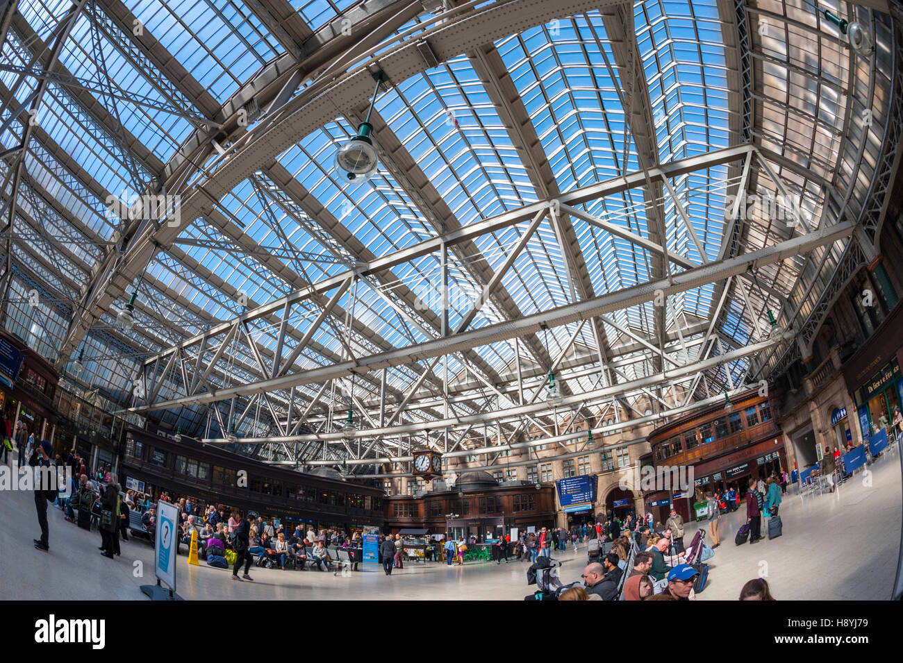 Looking up at the glass roof of Glasgow central station - Stock Image