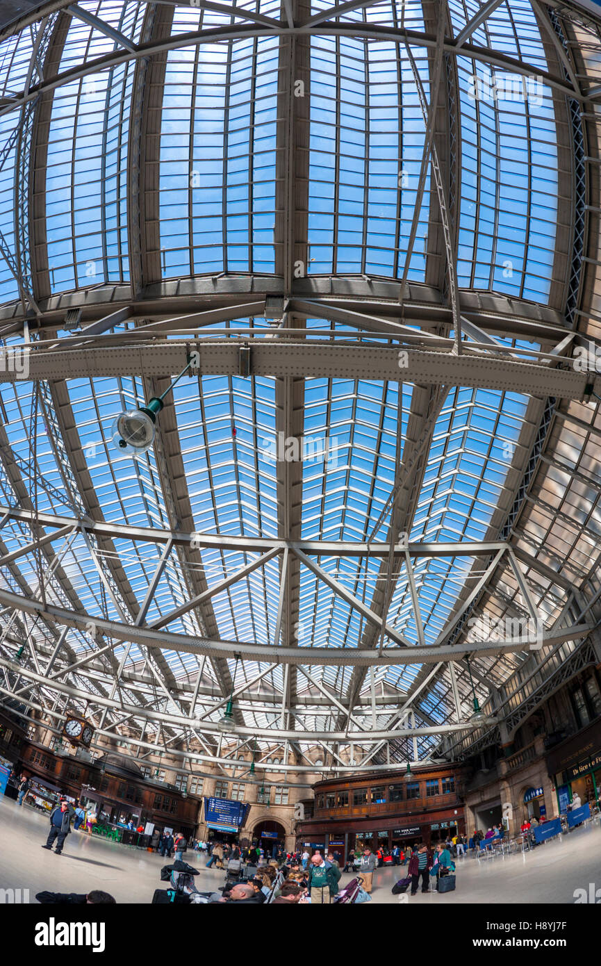 Looking up at the glass roof of Glasgow central station Stock Photo