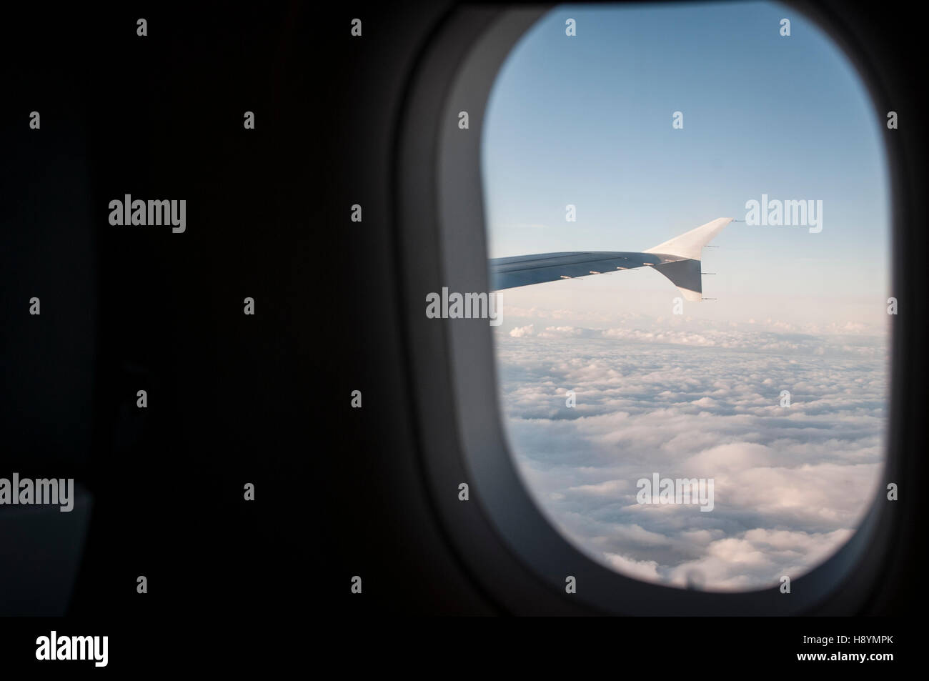 Looking out of an aeroplane window - Stock Image