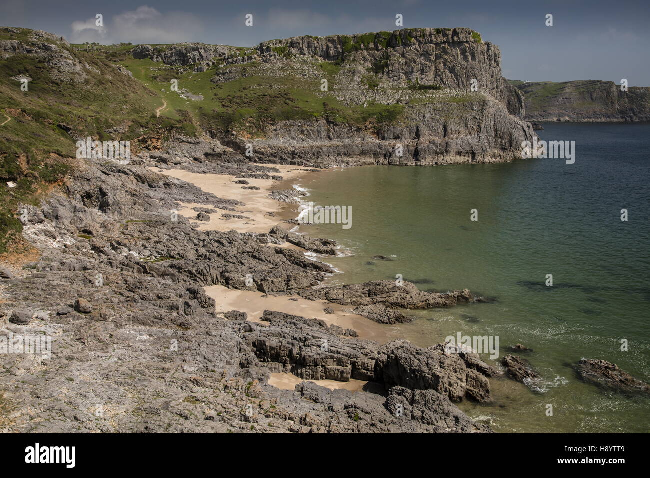 The south coast limestone cliffs of the Gower Peninsula, near Mewslade Bay; Gower Peninsula AONB, South Wales. - Stock Image