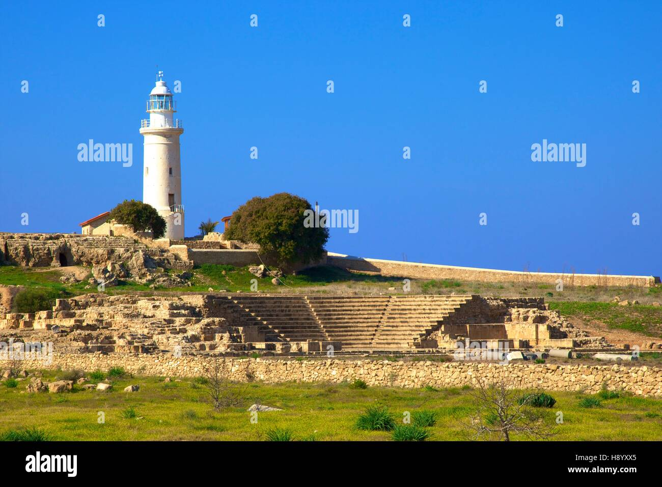 Lighthouse and Roman Odeon, Kato Pathos Archaeological Park, Pathos, Cyprus, Eastern Mediterranean Sea - Stock Image