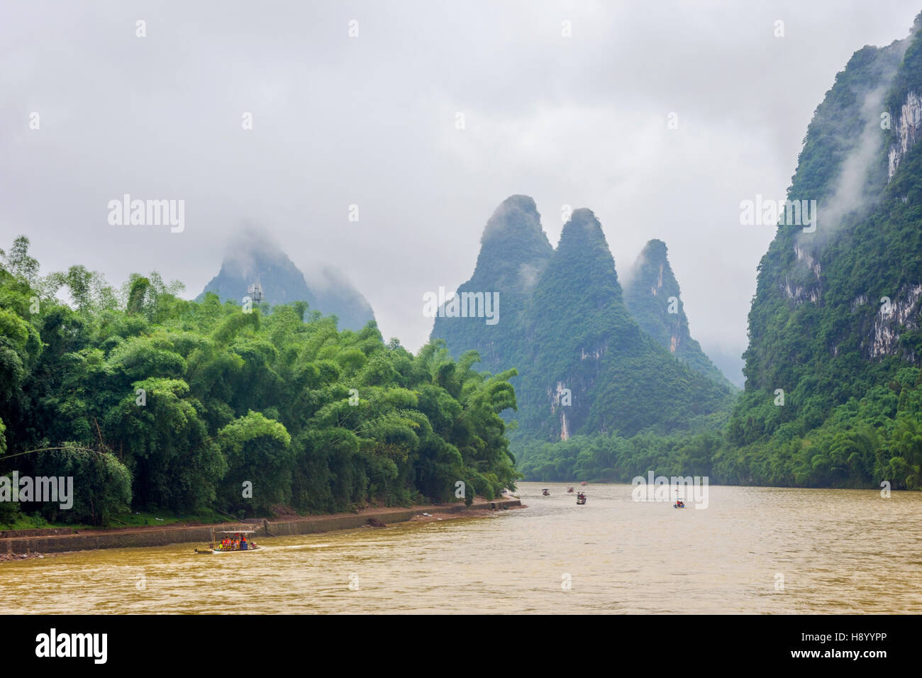 Li river with misty clouds and fog surrounded by famous karst mountains, Guangxi Zhuang, China Stock Photo