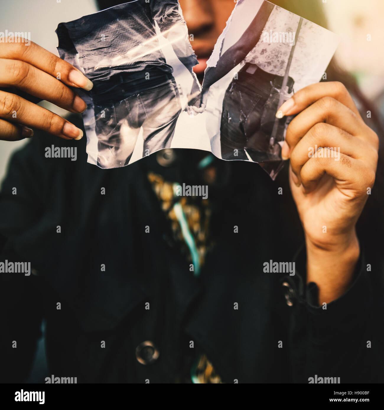 Girl Heartbroken Rip Photo Concept - Stock Image