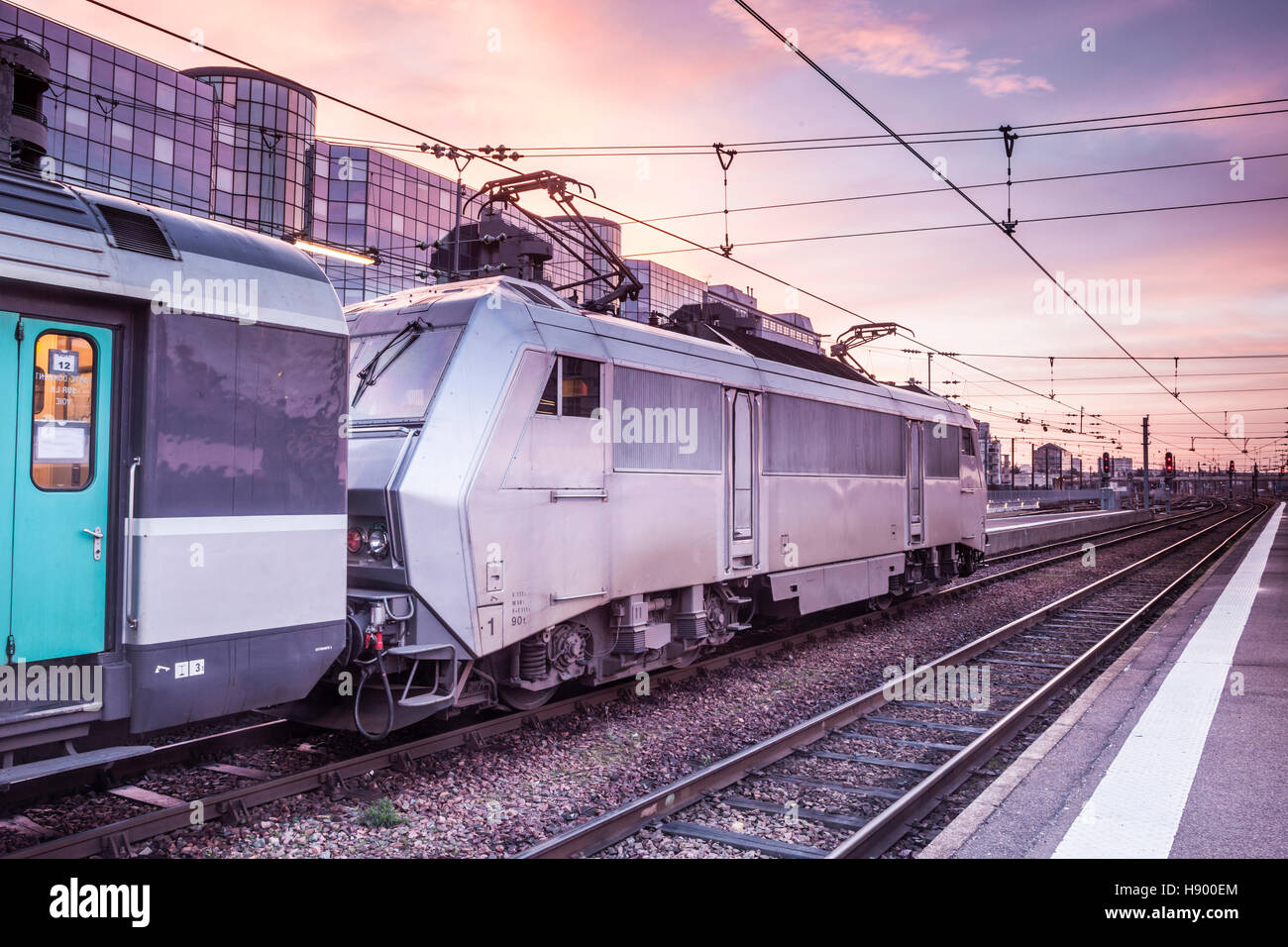 An intercity train awaits departure at Tours station. - Stock Image