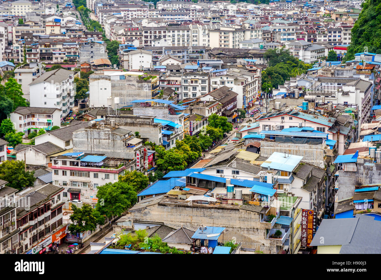 YANGSHUO, CHINA - JUNE 12: View over rooftops and buildings of Yangshuo city, Guilin prefecture. June 2016 - Stock Image