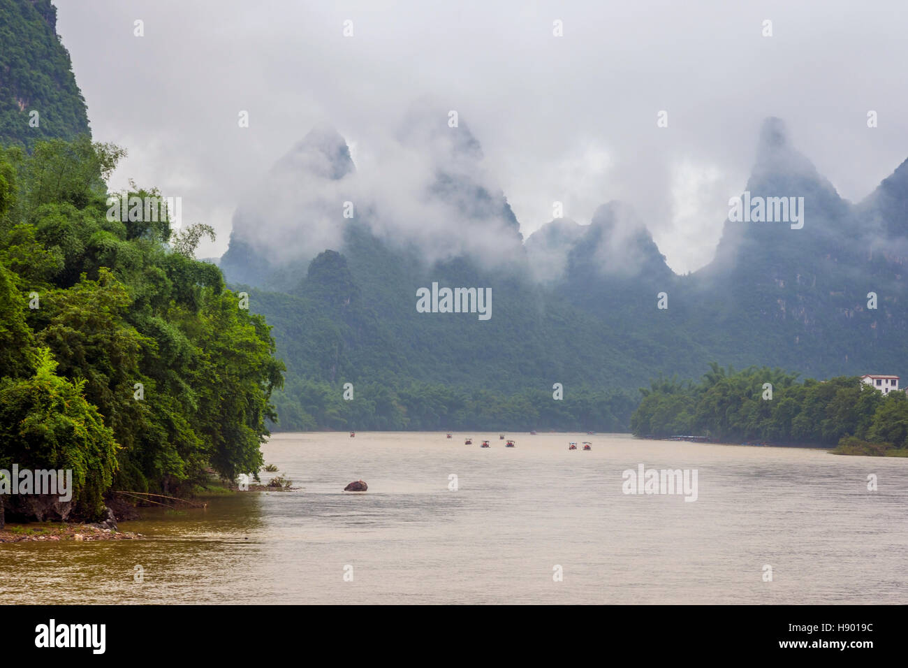 Bamboo rafts on Li river surrounded by karst mountains, Guilin, China Stock Photo