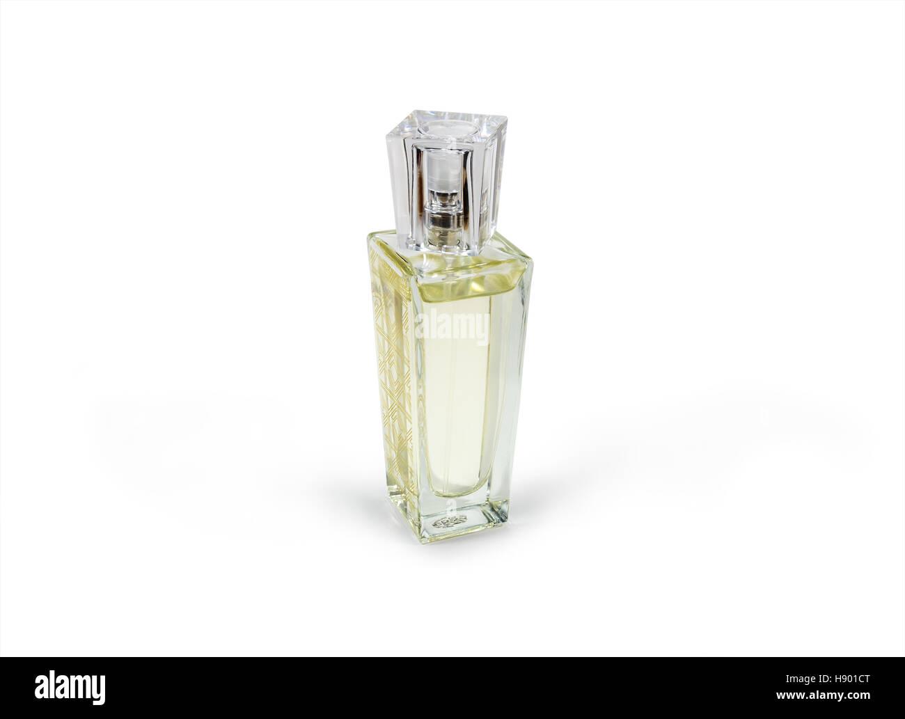 Elegant bottle of yellow perfume isolated on white background - Stock Image
