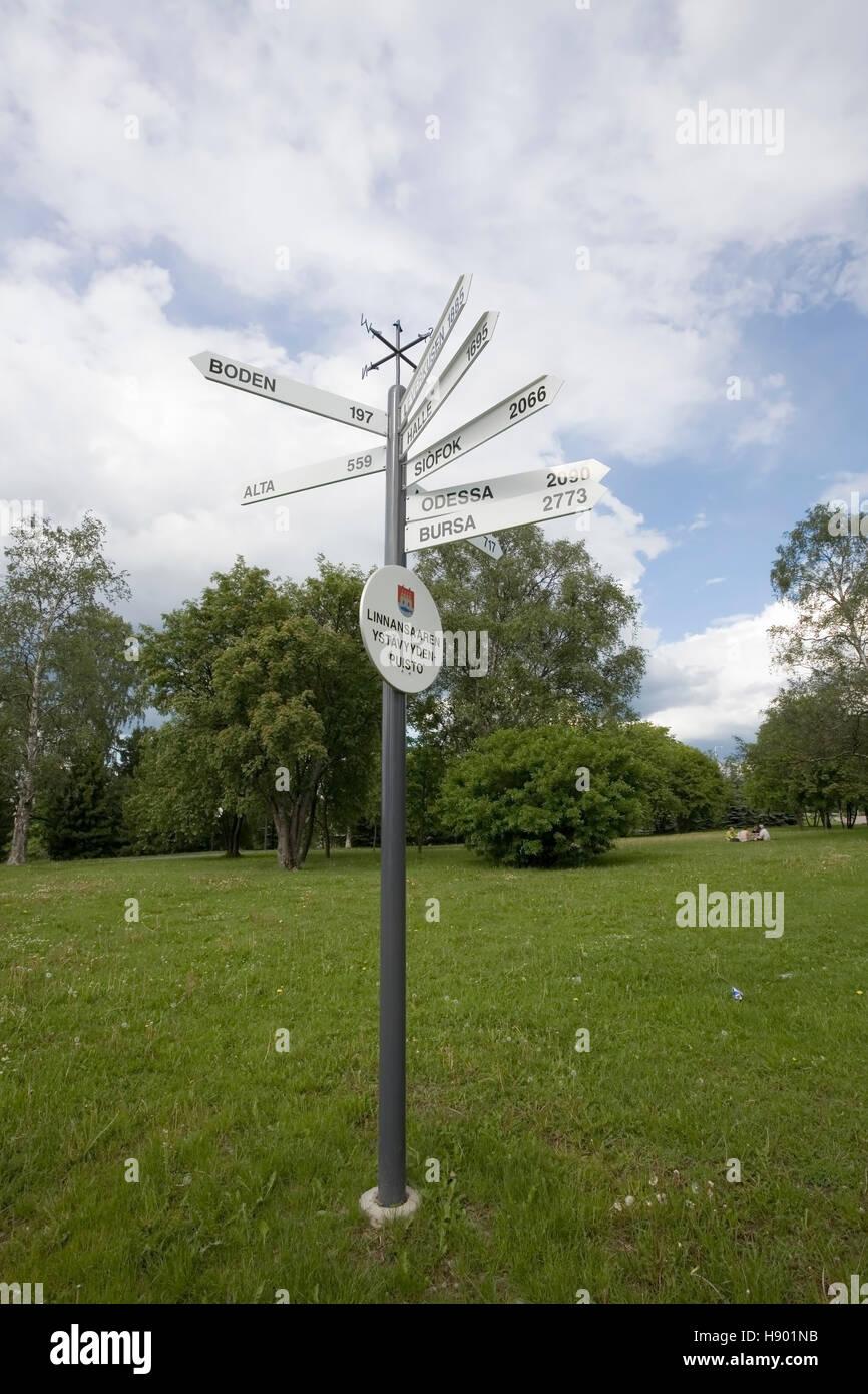 Distances sign pole, Oulu Finland - Stock Image