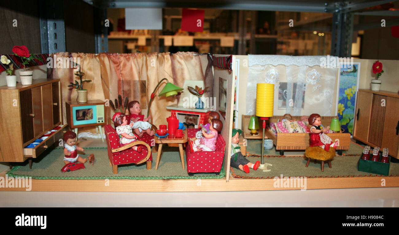 Scenes in a dollhouse meant to represent daily life in East Germany can be seen in the exhibition 'Experience - Stock Image