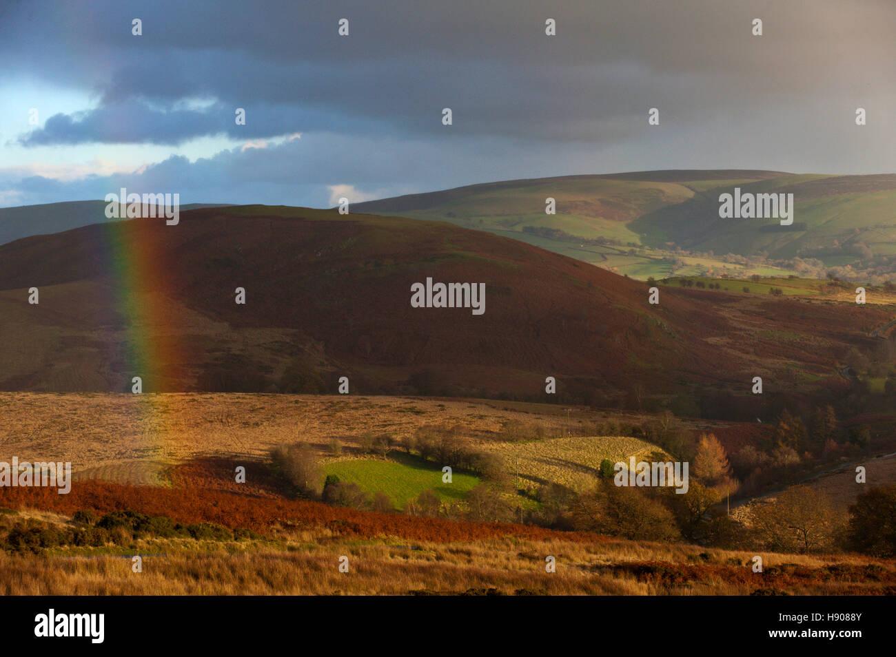 Llandrindod Wells, Powys, Wales, UK. 17th November, 2016. A rainbow is seen over the Powys landscape near LLandrindod - Stock Image
