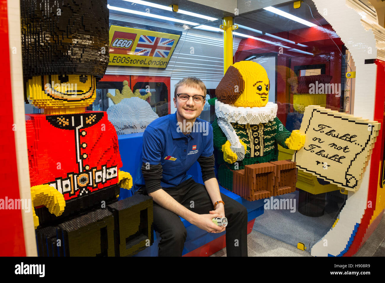 London, UK. 17 November 2016. A shop assistant sits in a tube train made of LEGO bricks. London's LEGO Store - Stock Image