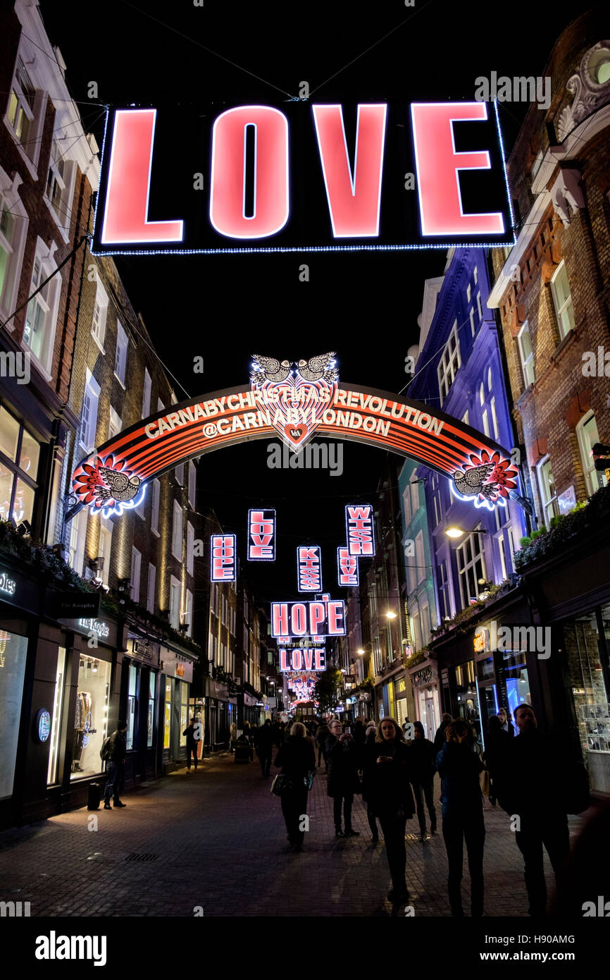 London, UK. 17 November 2016. London's trendy Carnaby Street provides its own interpretation of the Christmas - Stock Image