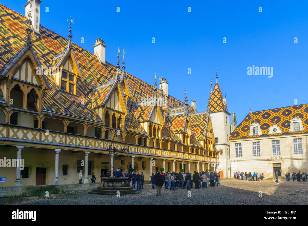 BEAUNE, FRANCE - OCTOBER 15, 2016: The Hospices of Beaune (historic hospital), with visitors, in Beaune, Burgundy, - Stock Image