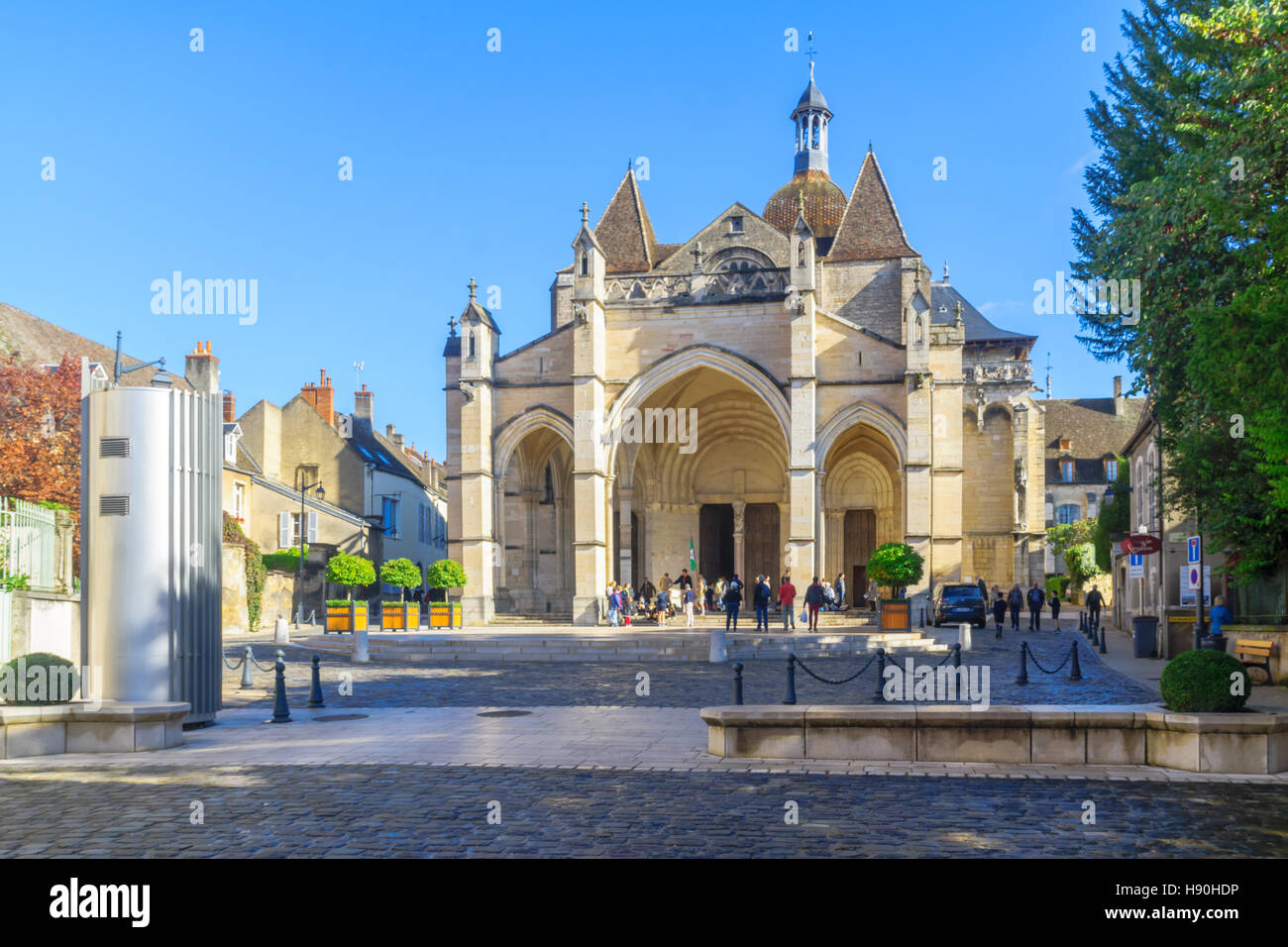 BEAUNE, FRANCE - OCTOBER 15, 2016: Scene of the Notre-Dame church, with locals and visitors, in Beaune, Burgundy, - Stock Image