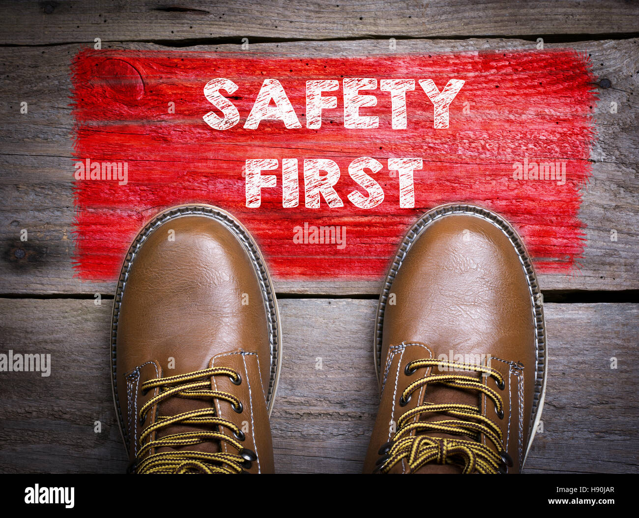 Safety First. Top View of Boot on wooden background - Stock Image