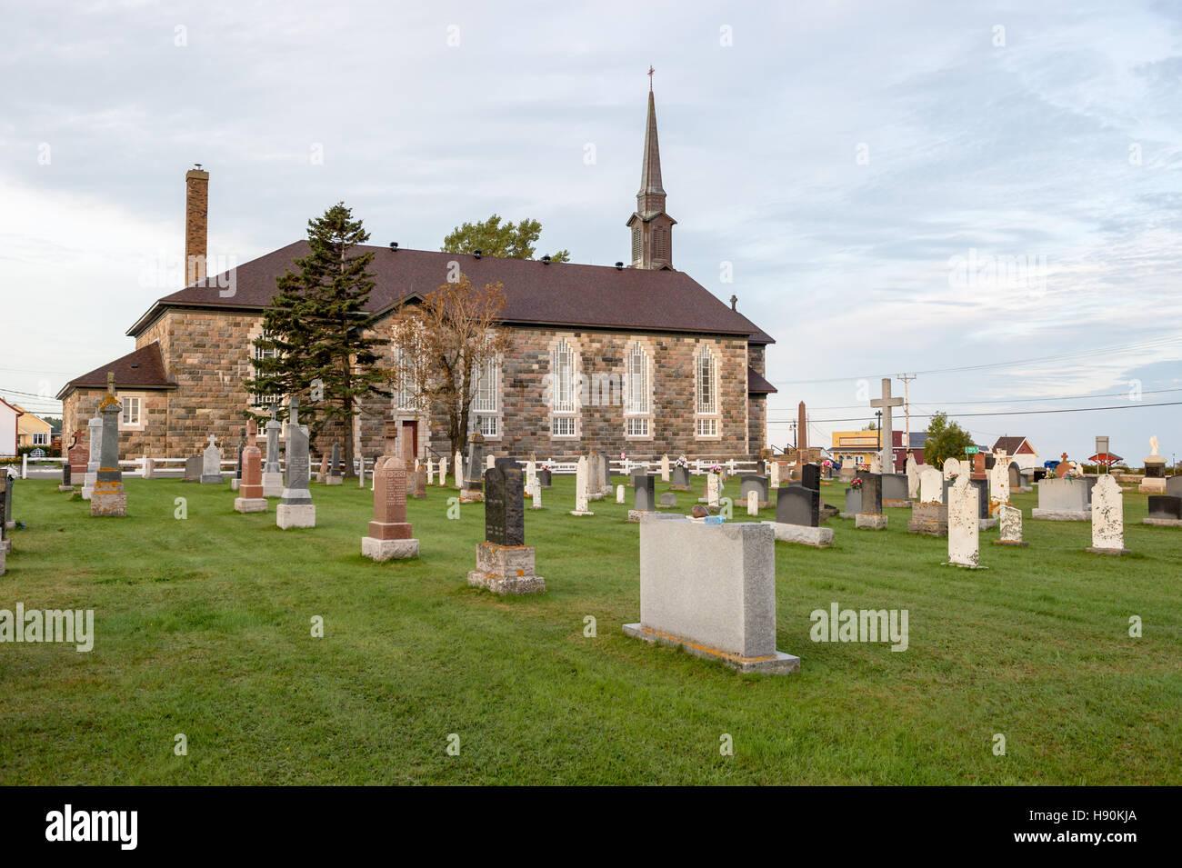 Sainte-Flavie Church and cemetery, Gaspe Peninsula, Quebec, Canada - Stock Image