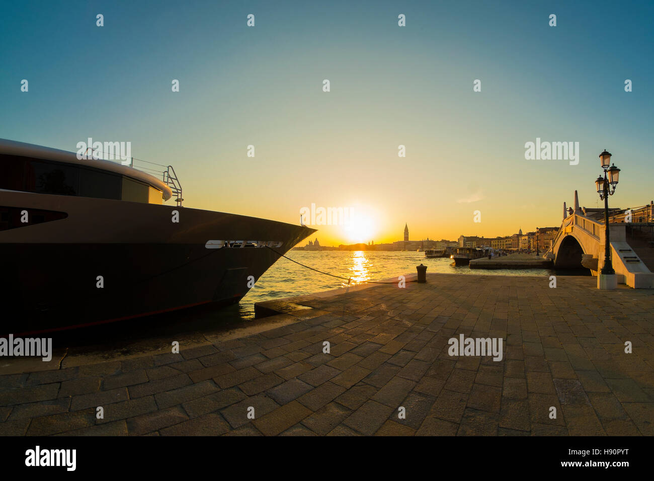 Sunset in Venice with luxury yacht. - Stock Image