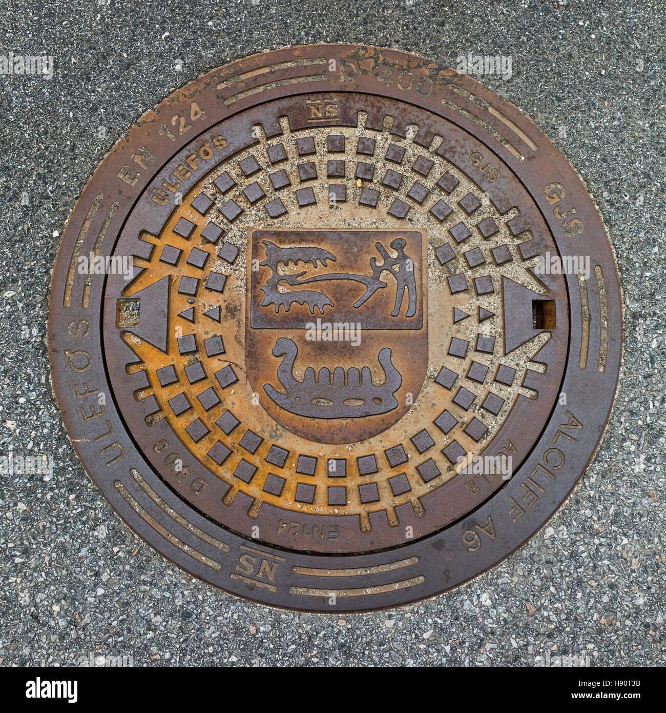 Manhole cover in the Tanum world heritage center, Sweden - Stock Image