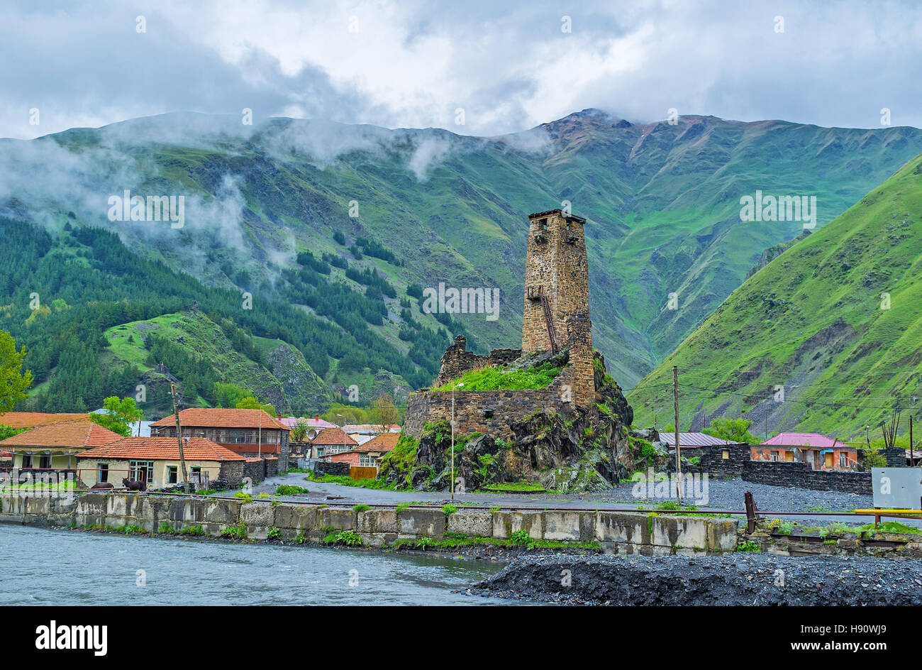 The ruins of the medieval castle of Sno village with high stone tower, built at the bank of Snostskali river, Georgia. - Stock Image
