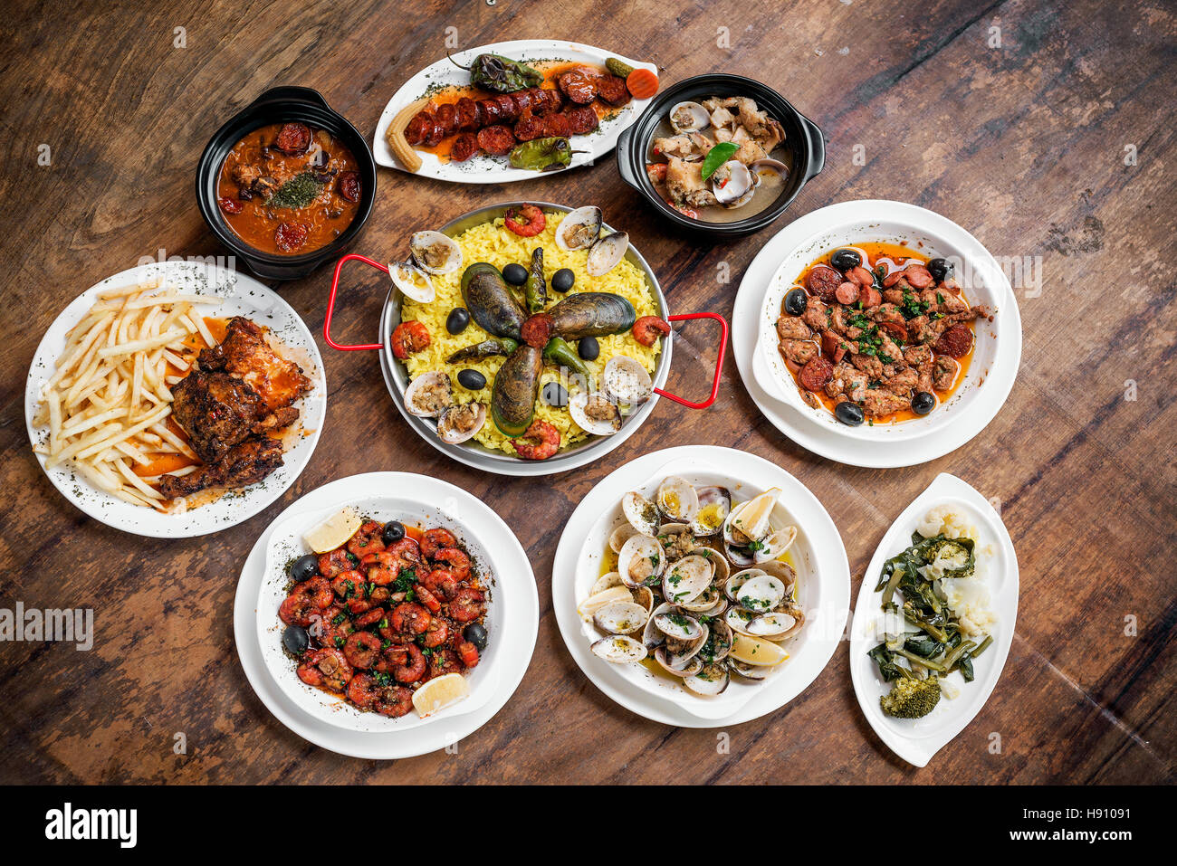 mixed portuguese traditional rustic tapas food gourmet selection on wood table Stock Photo