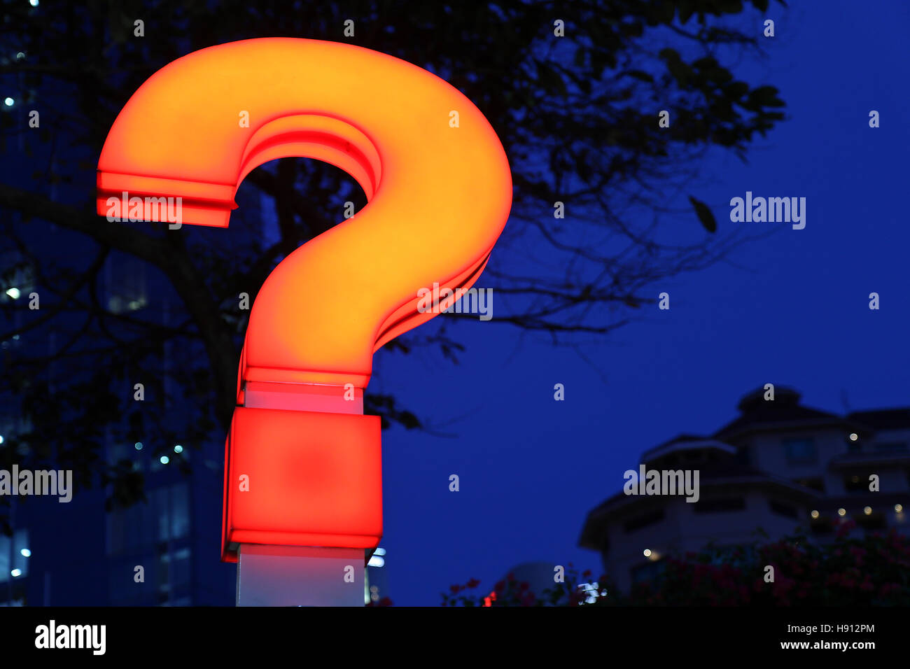 Illuminated question mark - Stock Image