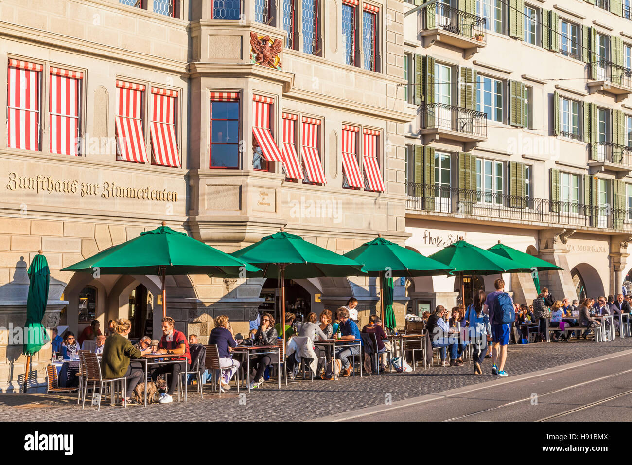 RESTAURANTS AT LIMMATQUAI QUAY, ZIMMERLEUTEN GUILD HOUSE, OLD TOWN, ZURICH, SWITZERLAND - Stock Image