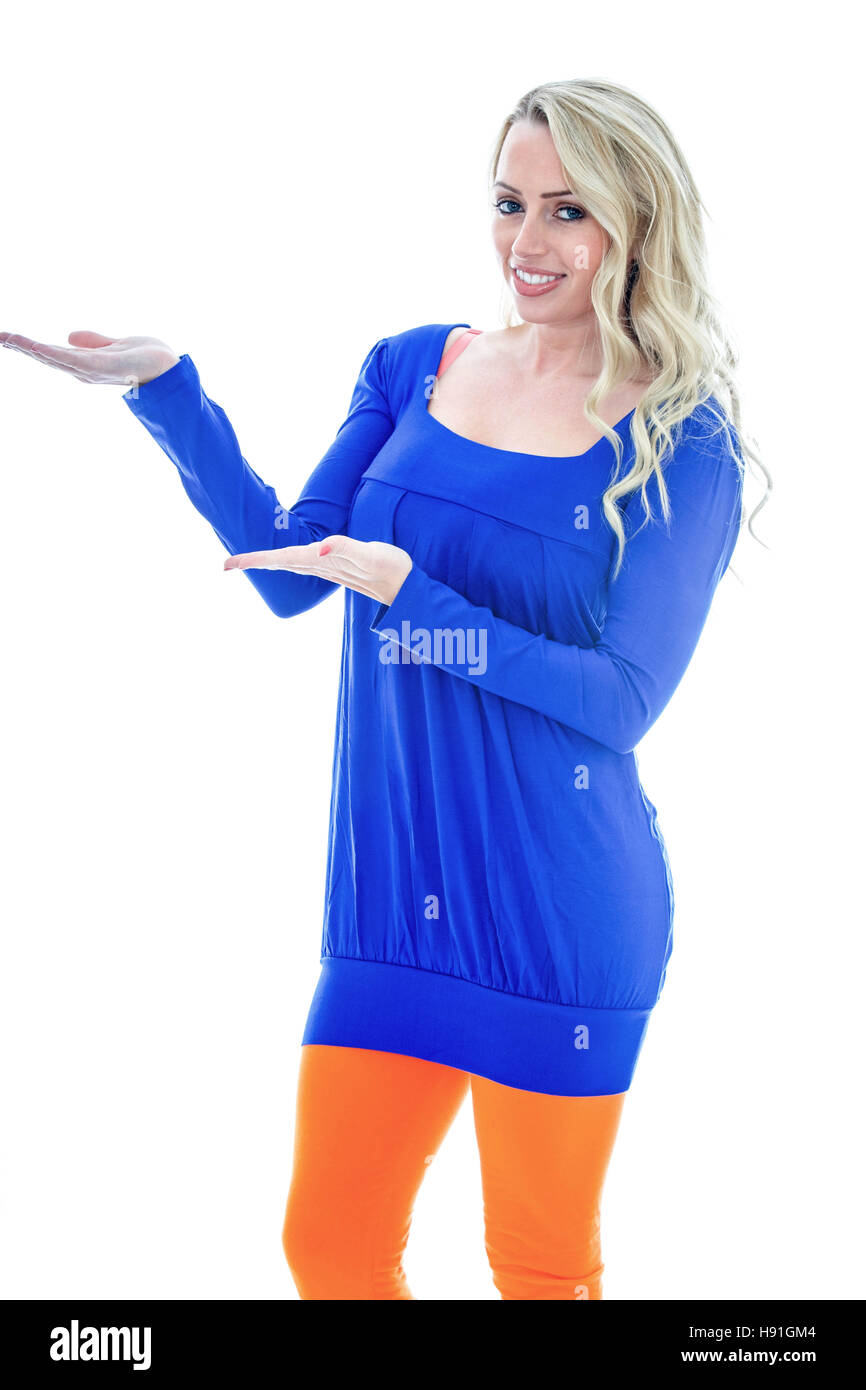 Girl Using Her Hands to Demonstrate Something Smiling Wearing a Short Blue Mini Dress Against a White Background - Stock Image
