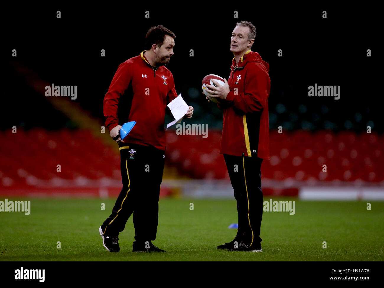 Wales coach Rob Howley talks with coach Matt Sherratt (left) during training session at the Principality Stadium - Stock Image