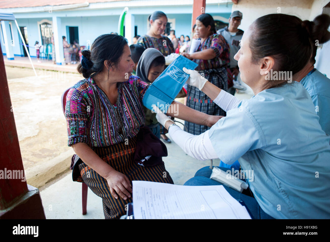 Maya indigenous people receive medical check by free clinic provided by local NPO in El Barranco, Solola, Guatemala. - Stock Image