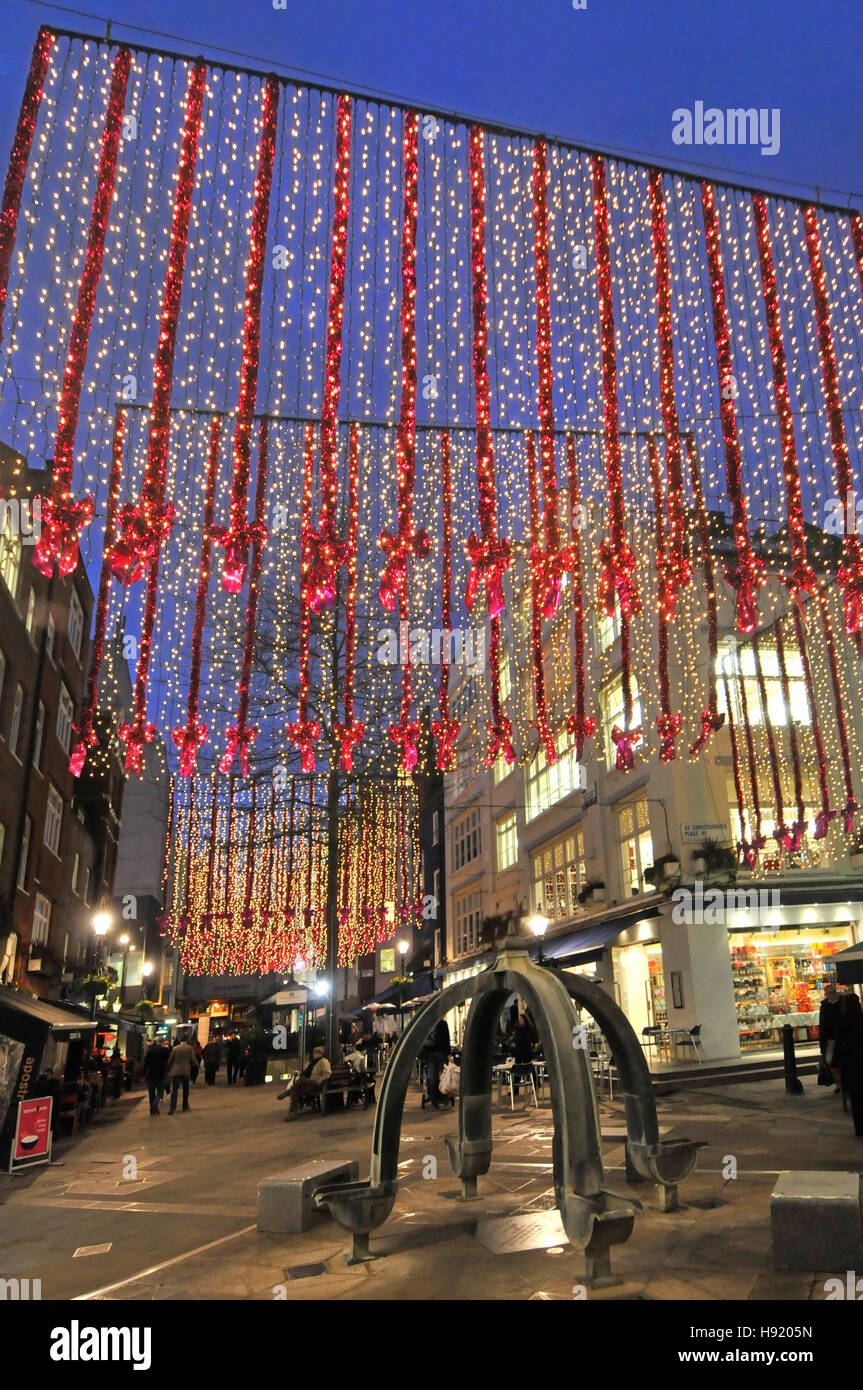 Christmas decorations London West End shopping eating out area many outdoor café & outside restaurant in - Stock Image