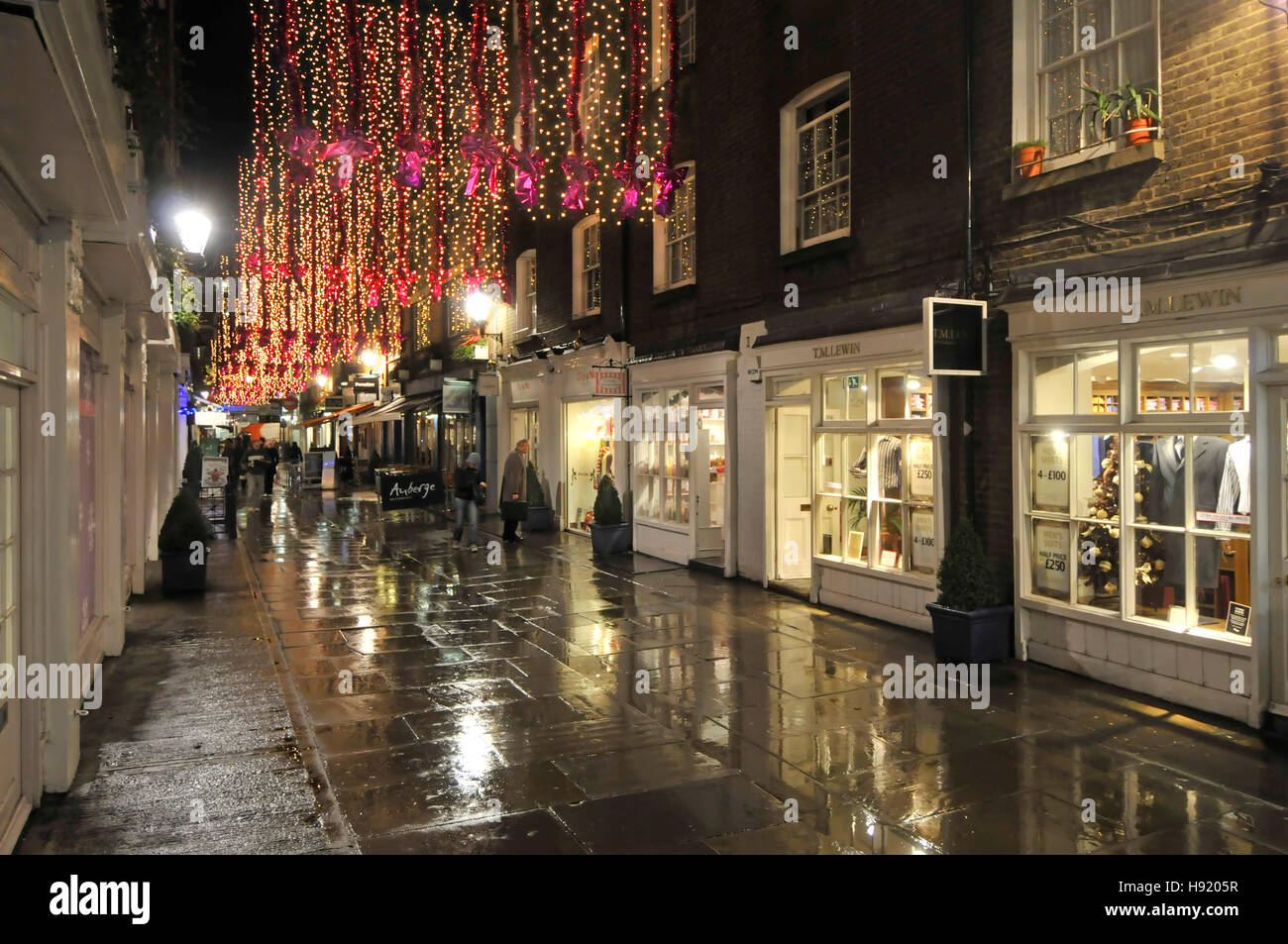 Christmas decorations lights London West End shopping eat out area with little upmarket shops St Christophers Place - Stock Image