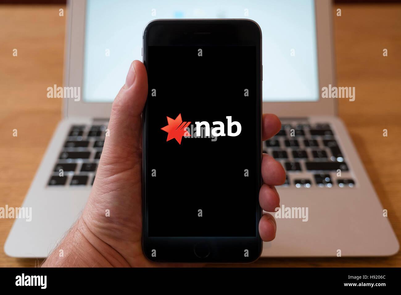 Using iPhone smart phone to display website logo of NAB, National Australia Bank - Stock Image