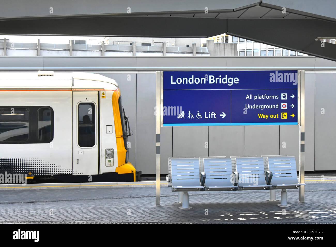 Train arriving at refurbished platform facilities at London Bridge Railway Station part of a major public transport - Stock Image