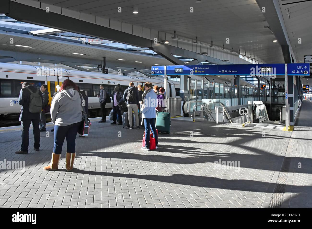 Commuters waiting on platform for train on refurbished platforms at London Bridge Station part of a major UK rebuilding - Stock Image