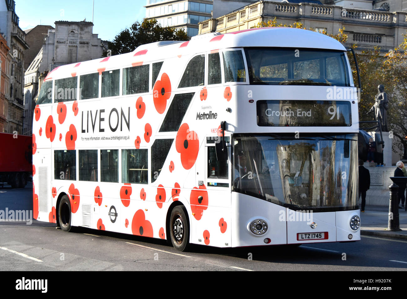 Public transport Boris bus double decker London bus operated by Metroline with poppy graphics to promote Annual - Stock Image