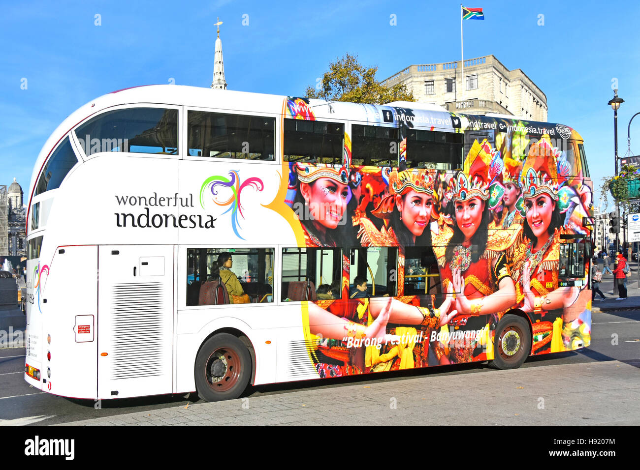 London double decker bus Indonesia tourism graphic design advertising & promoting Barong Festival in Banyuwangi - Stock Image